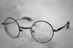 Clarity (karmakerosene) Tags: glasses snow winter stilllife blackandwhite monochrome monochromatic bw contrast depthoffield dof simple nikond7000 nikon d7000 35mm
