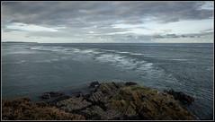 Tidal Turbulence (Donald Noble) Tags: antrim ireland northernireland rathlinisland boat clouds coast coastline headland marine rocks sea sky turbulence wake water wave waves