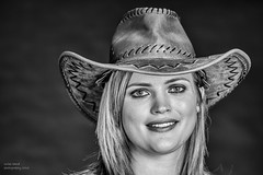 Louise (handmiles) Tags: mono monochrome blackandwhite bw model louise women modelnight hat accesory cowgirl pose look indoor inside blackbackdrop background backdrop smile sony sonya77mark2 sonya77m2 sony85mm f28 prime primelens mileshandphotography2016