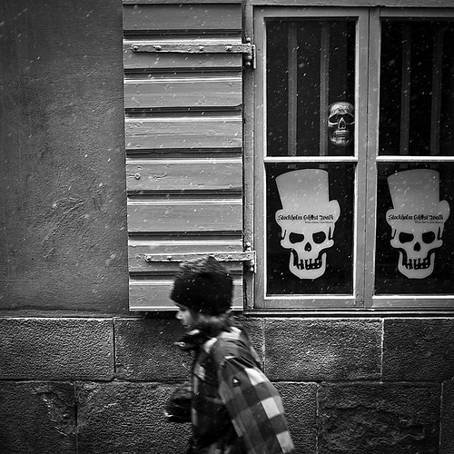 Stockholm Ghost Walk.. (Peter Levi) street city boy blackandwhite bw snow motion blancoynegro skull sweden stockholm streetphotography gamlastan skeletons oldtown x100 fujifilmx100 fujix100 fujifilmfinepixx100 stockholmghostwalk