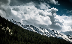 Something dark is coming (Florian Eymard) Tags: blue sky cloud mountain snow alps tree green pine forest landscape spring rocks peak mount aravis