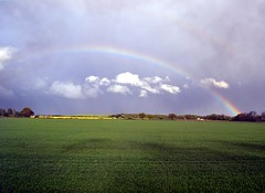 Rainbow (Stuart Axe) Tags: uk greatbritain england sky cloud storm green field weather clouds train rainbow view unitedkingdom yorkshire rail railway trains gb railtour railways 2012 rapeseed ecml