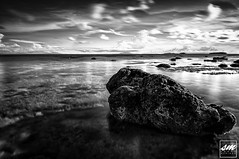 Sunset Beach in Mono (Sunny Merindo | Photography) Tags: longexposure sea summer sky bw black reflection beach rock stone clouds mono rocks tali philippines hdr smerindo sunnymerindo schultzpax schultpax sunnymerindoimages