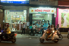 (kuuan) Tags: street restaurant evening f14 vietnam pharmacy shops mf 40mm saigon zuiko manualfocus penf gzuikoautosf1440mm