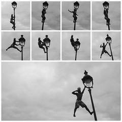 Stretching (Costruirecollego) Tags: street paris ball blackwhite streetlight busker parigi