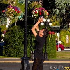 Juggler, Downtown Victoria, Vancouver Island, Canada (Amit Basu) Tags: red white canada english vancouver island hotel harbor leaf maple downtown bc fireworks harbour britishcolumbia flag secret crowd parliament columbia victoria gathering british empress canadaday independence quaint fairmont melee