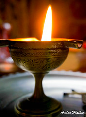 spreading light (Amlan Mathur) Tags: light lamp religious fire god indian prayer religion oil diwali brass puja engraved aarti diya ghee dussera janmashtmi wickflame