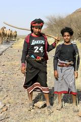 Yamen's camel Puncher (SAUD ALRSHIAD 2  ) Tags: fatherandson yemen nikon saudalrshiad msawr1 camels pouncher people