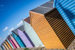 Number 81 (Sean Batten) Tags: hernebay england unitedkingdom gb kent beach beachhuts nikon df 35mm colors wood sky clouds