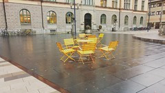 Chairs (Unmarriedswede) Tags: fristadstorget chairs rain town center hall