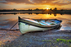 Last Light at Lowry's Lake (Alan10eden) Tags: lake lowrys hamiltonsbawn armagh fishing still reflections sunset dusk sunstar sunburst colours golden clouds october autumn light rowing boat shore sky countyarmagh ulster alanhopps canon 80d
