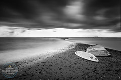 The Wait (SimonTHGolfer) Tags: windsurfer landscape blackandwhite sport water merseaisland essex longexposure shore board sail clouds nikon simontalbothurnphotography