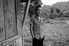Waiting (pacco_racco) Tags: village hmong man middlemekong northernlaos southeastasia leicam6 leicasummicron35mmf20asph kodaktrix400