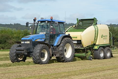 New Holland TM155 Tractor with a Krone Comprima CF155XC Baler & Wrapper (Shane Casey CK25) Tags: new holland tm155 tractor krone comprima cf155xc baler wrapper cnh nh blue baling baled silage baledsilage rathcormac silage16 silage2016 grass grass16 grass2016 winter feed fodder county cork ireland irish farm farmer farming agri agriculture contractor field ground soil earth cows cattle work working horse power horsepower hp pull pulling cut cutting crop lifting machine machinery nikon d7100 traktori tracteur traktor trekker trator cignik collecting