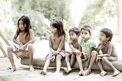 Batak children (Global Wildlife Conservation) Tags: batak cleopatrasneedle palawan philippines puertoprincesa southeastasia boy children community culture day forest girl indigenous log native people sitting tribe young