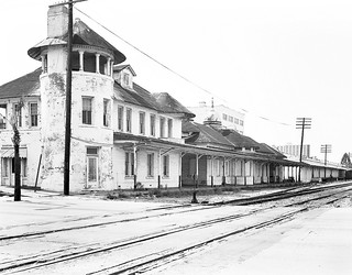 Seaboard Coast Line's old out of service Church Street Station is seen in a south - east view across the tracks at downtown Orlando, Florida, mid 1970's