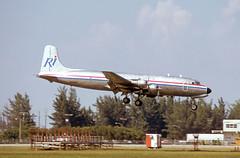 N4989V (Paul Thallon - Aviation Photos) Tags: miami mia douglas dc6 miamiairport kmia miamiinternational c118 44600 richinternational n4989v