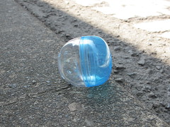 the prize is gone (Samm Bennett) Tags: street capsule plastic dropped downed