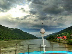 The Danube at Wesenufer, Upper Austria (echumachenco) Tags: houses sky water clouds forest austria sterreich wasser ship himmel wolken stern wald schiff danube obersterreich hdr heck donau huser upperaustria innviertel wesenufer iphone5