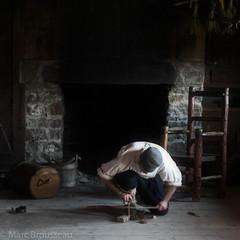 Sainte-Marie among the Hurons Fire Starter (mbrousseau) Tags: saintemarieamongthehurons museum ontario man fire hearth stick chair stone fireplace