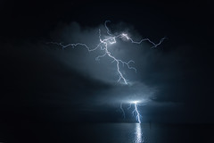Florida Lightning (Bobby Wummer) Tags: red thunderclouds thunderstorms storms stormchaser stormchasing lightning florida seascape ocean oceanstorm oceanscape outdoors weather palm beach island thunder landscapephotography photography longexposure