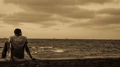 (C-47) Tags: morocco casablanca sea skyp human man back melancholy sepia