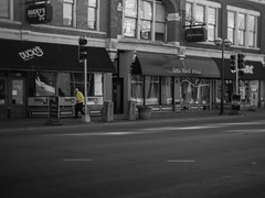 the Man in Yellow (L.M. Brown) Tags: yellow street photography picture moline urban city walking tux shop go more black white