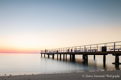 sunrise again (stavros karamanis) Tags: pier wharf sunrise longexposure bigstoper nd10stop hoya leefilters beach coast people sun colours sea seaside seascape morning canonusers canonphotography canon t3i tokina 1116mm f28 dxii cyprus larnaca ngc water outdoor bridge shore architecture landscape sky