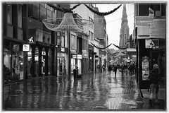 A rainy day in Eindhoven (jan_vrouwe) Tags: eindhoven rain street shoppingcentre shop church partylights umbrella glow