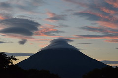 Darkening clouds gather over Volcan Concepcíon at sunset, Isla de Ometepe (nickdippie) Tags: volcano volcan ometepe isladeometepe volcanconcepcíon sunset volcanosunset clouds dramaticclouds scarfcloud pileus capcloud pinkclouds