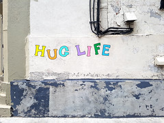 Hug Life (Exile on Ontario St) Tags: huglife montreal hug life letters color colors colorful colour thug message childish child lettres graffiti streetart street art urban urbain montral colourful colours vieux old vieuxmontral oldmontreal fridge magnets refrigirator magnet aimant aimants aimant mur wall funny cute hugging positive smile thuglife rap hiphop hip hop joke pop culture