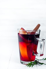 Mulled wine with cinnamon sticks (lyule4ik) Tags: mulled christmas drink food holiday hot cinnamon wine alcohol punch red spice table traditional white winter anise aromatic beverage grog heat ingredient refreshment rustic season seasonal tea walnut festive decoration orange photography homemade studio glass sugar delicious stick seasoning oranges gourmet copy dry bowl closeup isolated