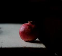 ''ivot je nekad siv ,nekad ut...'' / ''Life is sometimes a gray sometimes yellow...'' (ksenijaJ) Tags: black white pomegranate fruit pentacon vintagelense