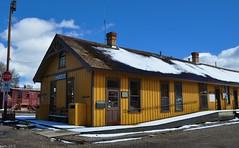 Yellow Depot (pam's pics-) Tags: railroad snow newmexico yellow train railway depot nm chama smalltown cumbrestoltecscenicrailroad northernnewmexico pammorris pamspics nikond5000 april2012roadtrip