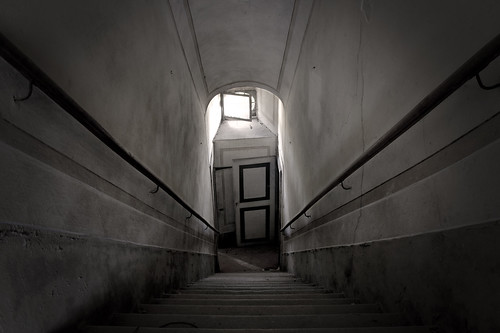 the door at bottom of stairs