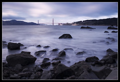Something Familiar (PatrickJamesPhoto) Tags: ocean sanfrancisco california ca longexposure light sunset sea sky seascape mountains color beach nature water rock clouds landscape flow coast rocks long exposure outdoor shoreline goldengatebridge filter shore nd density neutral pentaxk10d