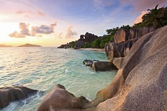 Sunset over Anse Source d'Argent - La Digue Seychelles (lathuy) Tags: ocean africa sunset sea sky mer beach night de stars island islands la soleil indian coucher ile boulders filter national tropical moonlight seychelles plage indien starry source geographic equatorial rochers digue praslin granit dargent ansesourcedargent mahé ndgrad mostbeautifulbeachintheworld