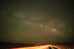 Milkyway and cars (CaptDanger) Tags: longexposure light usa newmexico southwest stars landscape photography photo highway telephone trails pole astrophotography nm f28 clearsky afterdark brakelights milkyway lightstreaks lateatnight noclouds southwesternus newmexicoskies iso5000 canon5dmarkiii rokinon14mm notastartrail milkywayrising potd:country=gb
