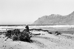 where have  you gone? (Ghostwriter D.) Tags: blackandwhite beach analog island spain lanzarote playa espana canaries isla famara nikonf80 cesarmanrique canaryisland nikkor14 playadefamara