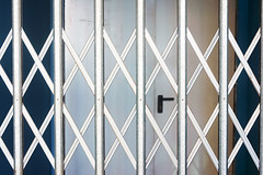 Cerrado (Mimadeo) Tags: door blue color window glass yellow metal shop grid store gate iron closed pattern exterior metallic background steel entrance vivid security front dirty business shutter roller secure safe grille protection rolling folding foldable