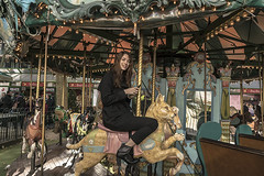 """Color of Autumn 2016 In NYC"" (Even Young Adults Like To Ride The Carousel In Bryant Park NYC) (nrhodesphotos(the_eye_of_the_moment)) Tags: dsc0498372 ""theeyeofthemoment21gmailcom"" ""wwwflickrcomphotostheeyeofthemoment"" colorofautumn2016innyc autumn season carousel bryantpark manhattan nyc outdoors girl ride poles mirrors reflections shadows lightfixtures animals women rider fun recreation"