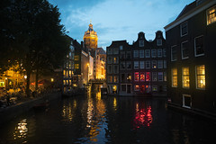 Amsterdam (LexSwamp) Tags: amsterdam dutch holland netherlands river canal landscape cityscape city town capital dusk night dark light lights orange red ambience mood evening late romantic shadows architecture village