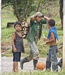 tres amigos (Pejasar) Tags: boys friends amigos dog machete basketball rural eltesoro guatemala children load cutwood cap rubberboots