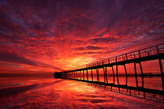 Unforgettable Sunrise (mr.alsultan) Tags: bridge red sky sun reflection water colors sunrise canon fire gulf explosion dream nat reflect kuwait couds q8 natgeo sigma1020 50d alsultan