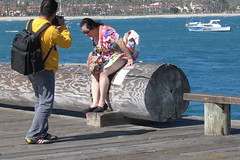 ♫ Strong Winds, Strong Winds…♪ (Viejito) Tags: ocean california camera blue sea woman usa black feet beach water girl sunglasses yellow santabarbara shirt lady america canon bench hair bag geotagged pier boat model américa waves waterfront dress unitedstates arms pacific legs skin wind fingers windy skirt tourist sneakers powershot jeans barbara pacificocean knees amerika winds currents gust s100 stearnswharf bárbara amérique canons100 geo:lat=34408591 geo:lon=119685015 johnpeckstearns