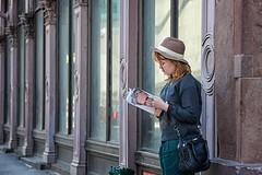 reading up (bytegirl24) Tags: street nyc newyorkcity windows hat magazine reading manhattan cooperunion newyorkmagazine