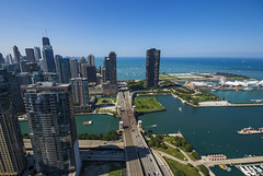 56 Stories Over Lakeshore Drive (John Hill Photography) Tags: blue roof sky lake chicago green cars rooftop water car skyline clouds floors sailboat canon drive harbor day michigan sigma led clear story shore lakeshore sail sailboats 1020mm stories 1020 56 t3i ultrawideangle 56th dockboats