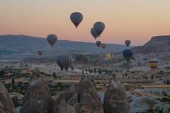 Take Off (Brian Hammonds) Tags: morning travel light shadow chimney sun mountain hot beautiful beauty rock vertical stone contrast sunrise trekking turkey balloons asian photography dawn early photo high asia day break photographer tour desert image hiking air exploring hill towers balloon flight picture peak images tourist east adventure explore fairy traveling discovery touring chimneys turkish cappadocia discover traveler goreme hight capadocia