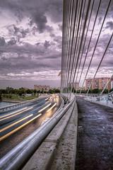 Puente del Alamillo al caer la tarde (Zu Sanchez) Tags: city longexposure bridge sunset cidade sky sun sunlight sol clouds canon puente sevilla spain ciudad seville ponte cielo calatrava nubes pont spagna gettyimages lighttrail siviglia cityart spagne puentedelalamillo citte sevillan sevillában alamillosbridge