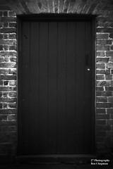 Dark door. (BenChapmanphoto) Tags: door old bridge bw white black brick texture monochrome canon dark lens toy rebel holga soft lock decay framed lincolnshire plastic fens sutton 450d